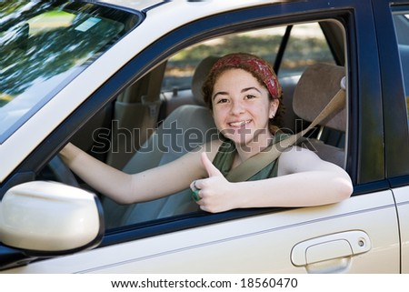 stock photo : Cute teen driver giving the thumbs up after passing her ...