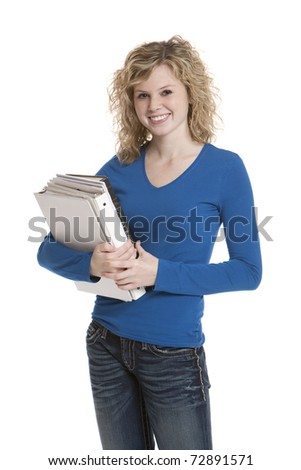 Cute teenage girl holding books on white background