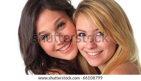 Cute teenage girls, best friends, smiling and hugging.