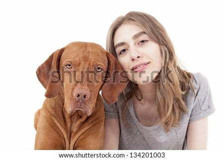 cute teenager girl and golden dog on white background