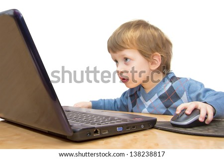 Cute three years boy with laptop isolated on white background