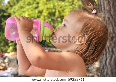 Cute toddler drinking water