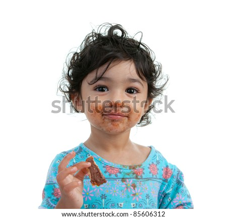 Cute Toddler Girl Eating a Chocolate Cookie, Isolated, White