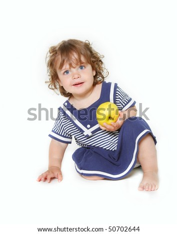 cute toddler girl with green apple over white