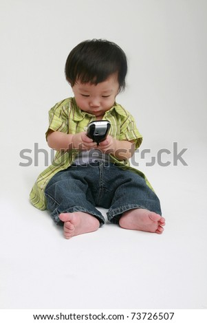 Cute toddler texting