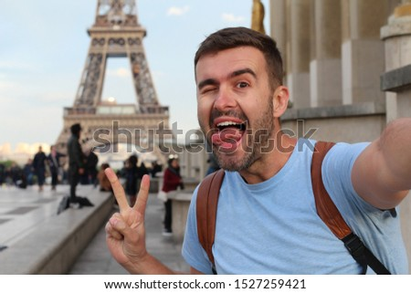 Cute tourist taking a selfie in France