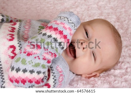 Cute two month old smiling baby girl