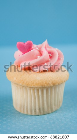 Cute Vanilla Cupcake with Pink Frosting and Candy Heart