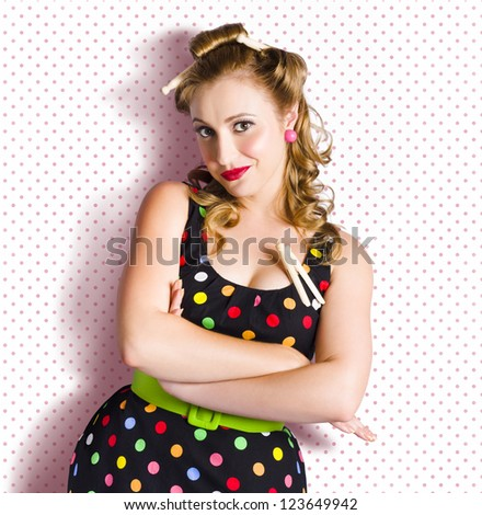 Cute Vintage House Maid With Old Wooden Pegs In Hair On Retro Polka Dot Background With Copyspace