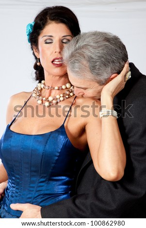 stock photo cute white mature couple in romantic moment with the man kissing the base of her neck and she is 100862980 Crystal Clear