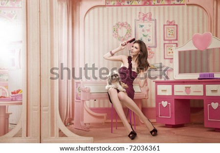 Cute woman as a doll in her living room