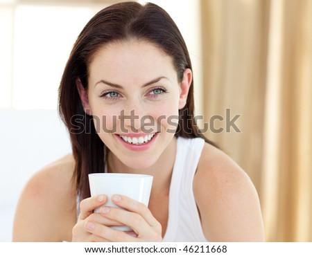 cute woman drinking a coffee...