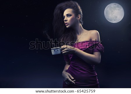 Cute woman drinking coffee on the midnight