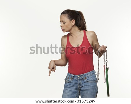 cute woman expressive on isloated white background having authority on her dog