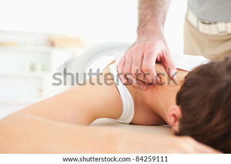 Cute Woman getting a neck-massage in a room