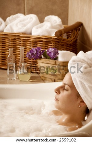 cute woman in a bath in a local spa
