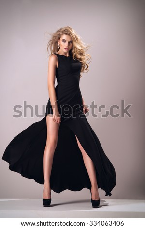 Cute woman in gorgeous dress