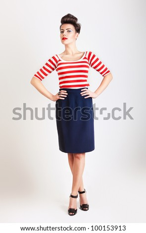 cute woman in t-shirt and skirt - stock photo