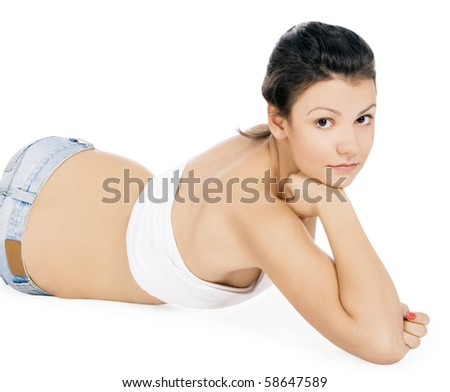 Cute woman lying on the floor isolated over a white