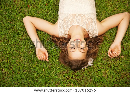 cute woman lying on the grass