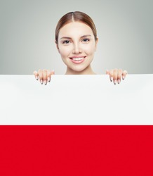 Cute woman showing the Poland flag background. Travel and learn polish language concept