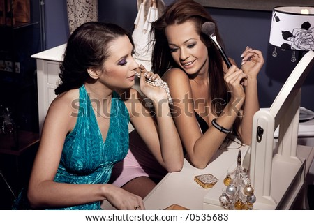 Cute women sitting next to the dressing table