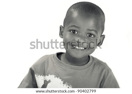 Cute 3 year old black or African American boy in black and white smiling