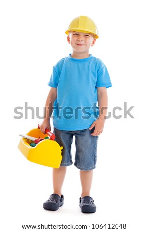 Cute 3 year old boy dressed as a construction worker isolated on white