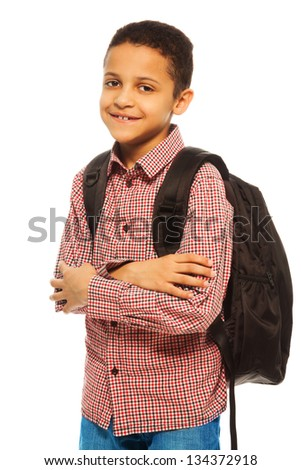 Cute 8 years old black boy with backpack - waist up portrait isolated on white