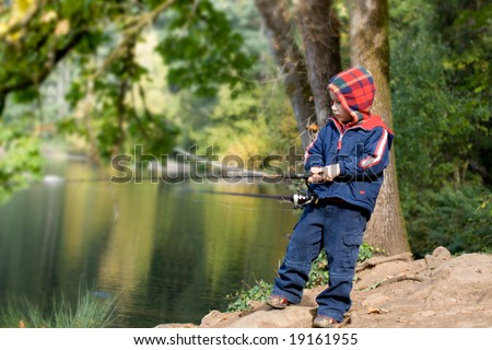 Cute 4 years old fisher boy