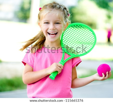 Cute 6 years old girl with racket
