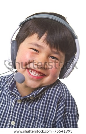 Cute young asian boy with great smile wearing a gaming headset  isolated on white background