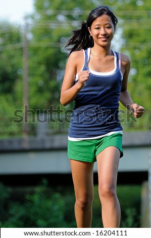 Cute young Asian woman running
