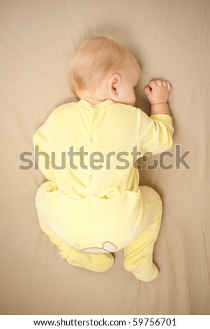 cute young baby sleep on bed. shot from top
