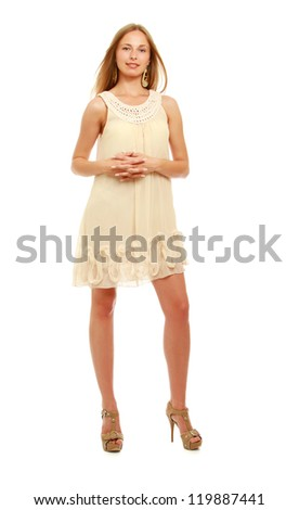 Cute young blonde woman posing in stylish dress. Full length portrait isolated on white background