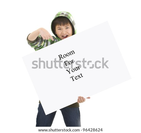 Cute young boy holding a sign with room for your text isolated on white background