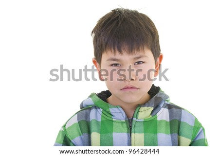 Cute young boy with a serious look isolated on white background
