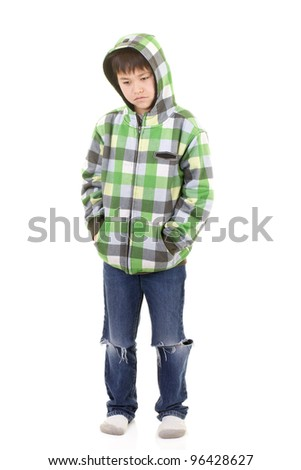 Cute young boy with bored or sad look in colorful hoodie isolated on white background