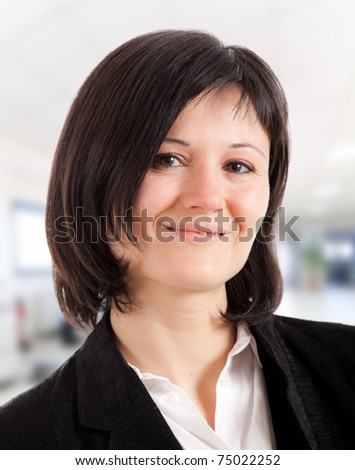 Cute young businesswoman in her office