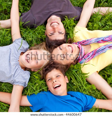 cute young family having fun in the nature