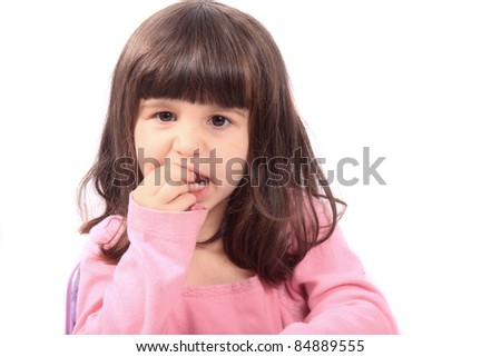 Cute young four year old child holding her tooth which may be loose or aching - stock photo