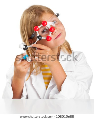 Cute young girl doing science experiments