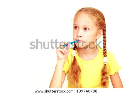 cute young girl learning on white background - stock photo