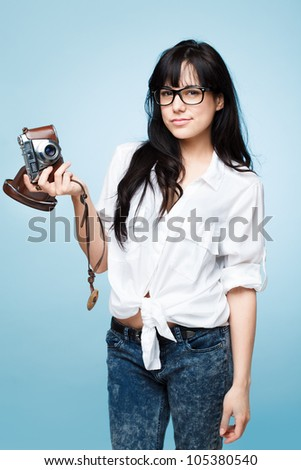 cute young girl photographer holding retro camera is a hipster