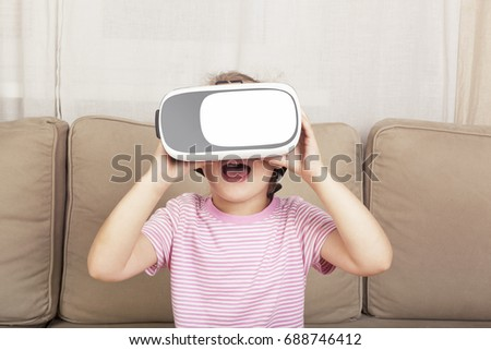 cute young girl with virtual...