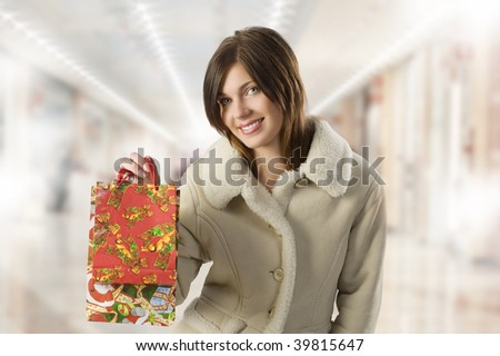 cute young girl with winter coat and christmas shopping bags