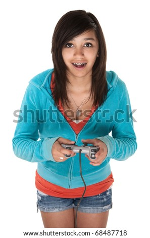 Cute young Hispanic teen using a video game controller