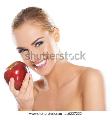 Cute young lady holding red apple while isolated on white