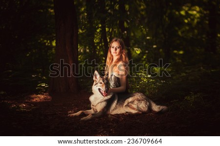 Cute young lady sitting with grey dog