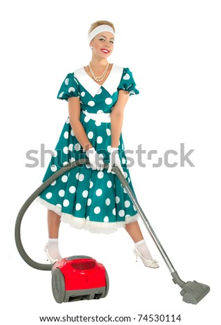 cute young retro housewife with vacuum cleaner
